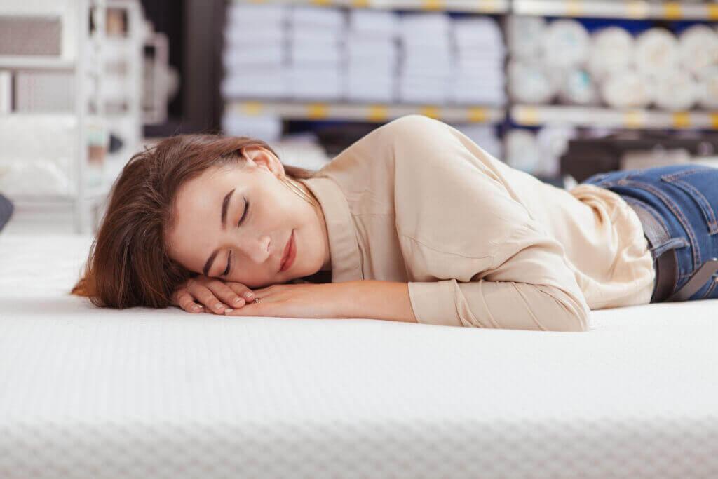 beautiful woman shopping orthopedic mattress