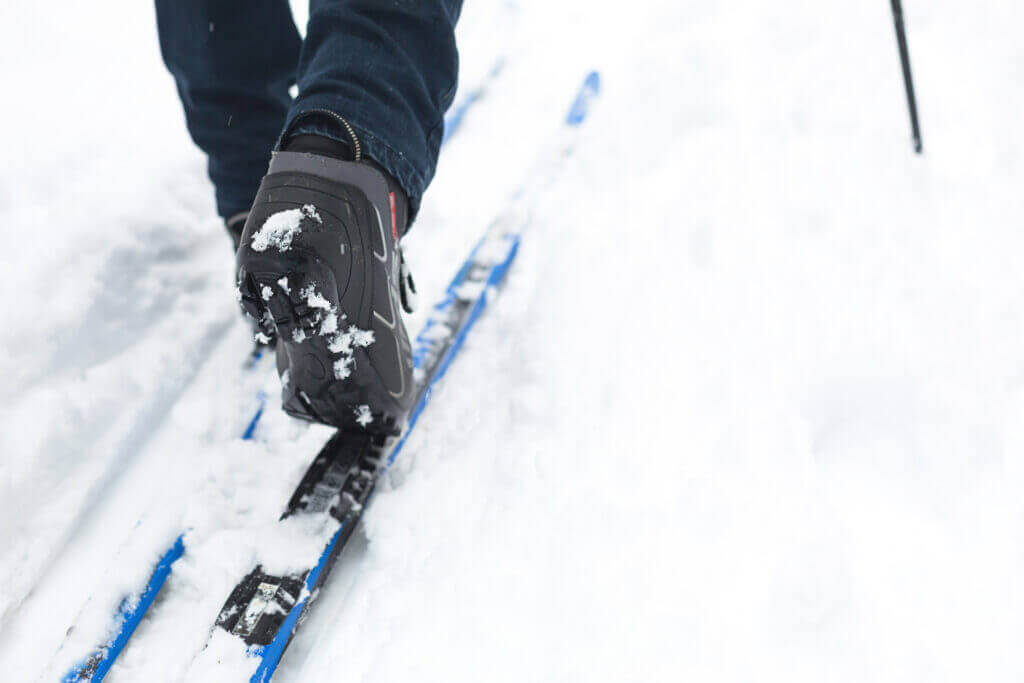 feet skier ski boots cross country skis walking snow winter sports healthy lifestyle close up copyspace