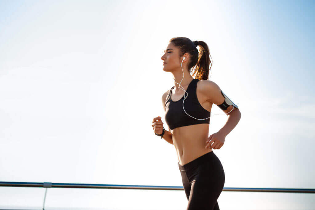 young attractive fitness girl jogging