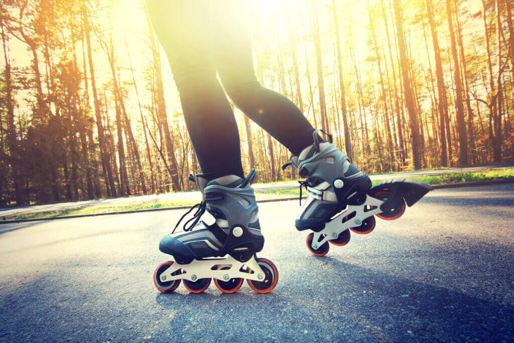 teenage girl on roller skates at summer