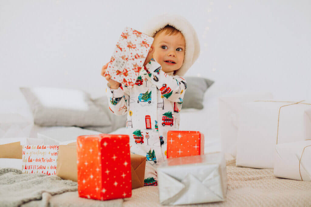 cute boy santa hat openning presents christmas