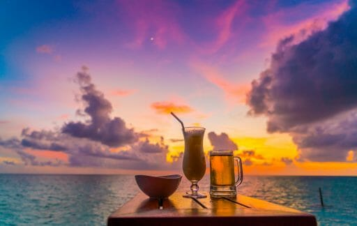 glass beer with beautiful tropical maldives island