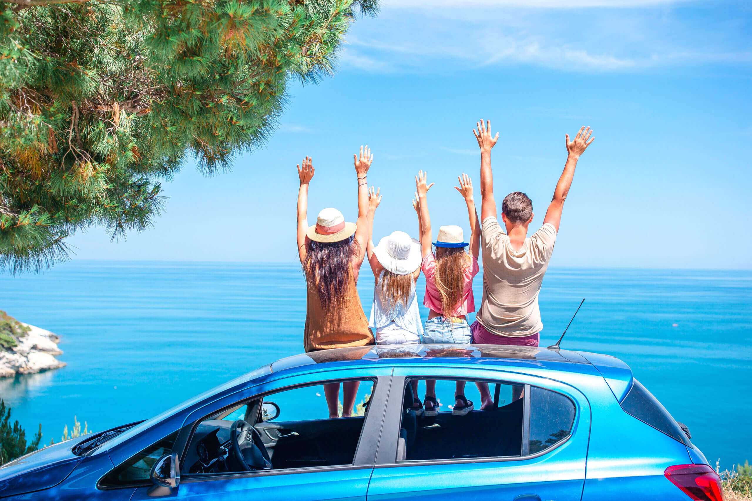 summer car trip young family vacation scaled